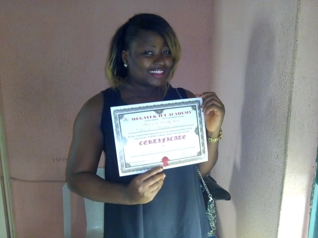 Amarachi displaying her Certificate after Completion of her