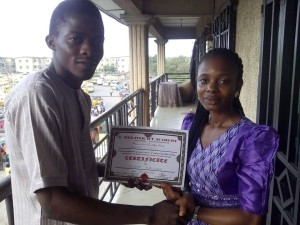 Blessing receiving her Certificate after completion of her training